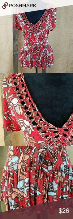 "Deletta Anthropologie women's L short sleeve V-nec Deletta Anthropologie women's L short sleeve V-neck floral peplum, very soft fabric, tied back.  Under arm to under arm: 21"" Back up down: 27"" Anthropologie Tops Blouses"
