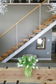 modern floating staircase and cable railing