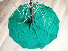 This lacy Christmas tree skirt with pom-poms is sure to be your next heirloom-in-the-making.