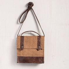 """So hip and stylish, you can't go wrong with the Everyday Crossbody bag. It features natural khaki canvas and genuine leather accents with two roomy slip pockets for essentials and a 23"""" leather strap. This bag is ready to hit the town!8.5"""" W x 8.5"""" H x 2.5"""" D. Waste not, is the concept behind these awesome bags from Mona B. Why make new materials when there are interesting and perfectly usable fabrics that can be recycled or upcycled. Mona B's goal is to reduce and reuse some of the worlds…"""
