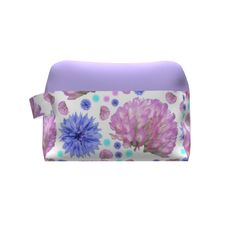 Grainline Studio Portside Dopp Kit made with Spoonflower designs on Sprout Patterns. Clover flowers and bachelor buttons in pink, purple and blue on  a white background with a lavender accent.