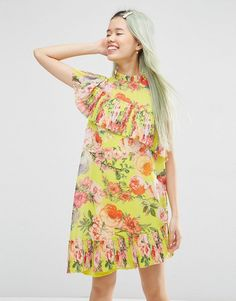 Buy it now. ASOS Pleated Shift Dress in Bright Acid Floral - Yellow. Dress by ASOS Collection, Lined chiffon, All-over print, High neckline, Asymmetric pleated trims, Button keyhole back, Loose fit - falls loosely over the body, Machine wash, 100% Polyester, Our model wears a UK 8/EU 36/US 4 and is 175cm/5'9 tall. ABOUT ASOS COLLECTION Score a wardrobe win no matter the dress code with our ASOS Collection own-label collection. From polished prom to the after party, our London-based design…