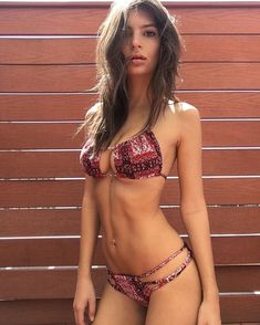 Pin for Later: You'll Melt Just Looking at These Hot Celebrity Bikini Moments  Emily Ratajkowski slipped into a seriously sexy cutout string bikini this Spring.