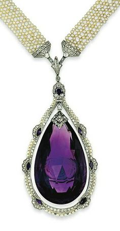 An early 20th century amethyst and seed pearl sautoir. The central briolette-cut amethyst pendant with old brilliant and rose-cut diamond cusp, within an old brilliant and rose-cut diamond articulated frame with marquise-cut amethyst detail and seed pearl border and amethyst and diamond palmette cluster surmount, to a seed pearl trellis-work necklace with amethyst and rose-cut diamond clasp, circa 1915
