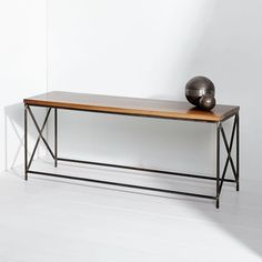 Brian Preston named his company Lamon Luther after his grandfather, a farmer and carpenter. The business provides job opportunities for people transitioning out of homelessness in his Georgia community. Each bench is made by hand from start to finish using high-quality materials, from its solid walnut wood top to its manually welded rebar base. Its clean lines and twice-lacquered finish will stand the test of time.