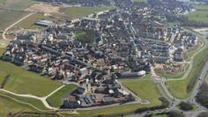 An aerial of Poundbury. Bridport Road, the town's central east-west avenue, connects it to Dorchester, a county town with a population of 20,000.