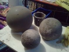 Concrete Balls made with sphere lamp covers. Can add pipe before pouring cement to make a channel for pump hose. Can use Pure Expansive Concrete for different effect.