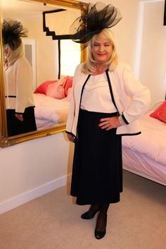 Suzanne models Jacques Vert suit with black fascinator, just another fantastic transvestite.
