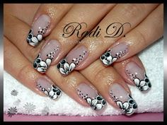 Classic french manicure with white- black- grey flowers.