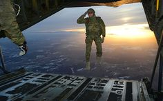An American soldier assigned to 1st Battalion, 10th Special Forces Group (Airborne) salutes his fellow soldiers