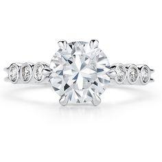 Handmade modern engagement ring by Leo Ingwer with bezel-set side stones.