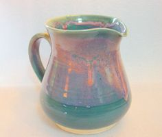 Wheel Thrown Pottery Pitcher in Teal and Pink. $30.00, via Etsy.
