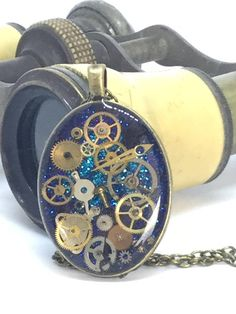 Timeless blue oval steampunk pendant