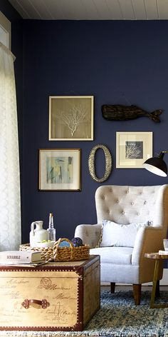 A stunning way to add indigo to a room is by painting a wall in this tone, shown in the image above from HomeGoods. The secret to making this color work is to pick the rest of the accents in softer neutral colors. Think driftwood tones, natural raw fibers or bronze details.