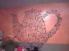 Anthropologie wall art display in the Seattle U Village store. A teapot made of spoons...each spoon had a hole drilled through to nail to the wall. So fun! crafty
