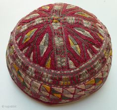 """Hat. Tekke Turkmen hat. Silk embroidery over entire surface of hat; excellent used condition; printed-cotton lining. 21"""" circumference x 7"""" diameter x 3.5"""" high."""