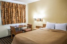 Guest room with table and chairs | Rodeway Inn | Albuquerque, NM
