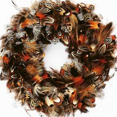 25a57dc6c0d Pheasant Feather Wreath by Plucking Fabulous. This fabulous wreath made  from a mix of cock