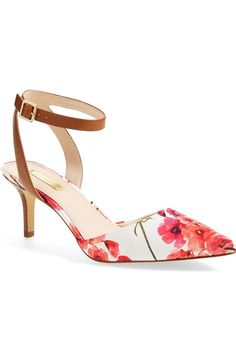 A skinny ankle strap tops this lofty pump from Louise et Cie. The ruby-hued floral print is perfect for spring and summer!