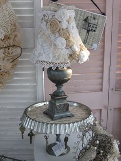 Look at the lamp shade   is that a tart pan turned upside down?  yes it is !!!! So many cool ideas here.... JP