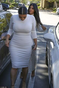 Check it out:Kim looked not at all self-conscious as she walked through a parking lot just outside of Los Angeles