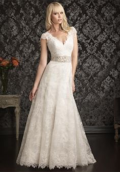 9016 by Allure Bridals -- Rich lace applique on soft net. Sculpted neckline with scalloped ca-sleeves with empire waist.