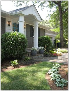 The front portico (is that what it's called) gives the house such presence and the window boxes and shutters are so charming! Description from tphblog.com. I searched for this on bing.com/images