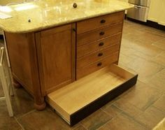 How to Add Toe Kick Drawers for More Storage...I like the idea of these kick drawers.  Less wasted space.