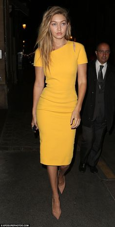 Mellow yellow: Gigi Hadid put on another gorgeous display as she stepped out in Paris on Friday evening, wearing a figure-hugging dress