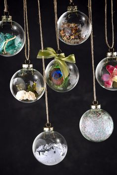 Create your own unique Christmas ornaments by filling clear glass ball ornaments with feathers, crystal fibers, preserved flowers, moss, and more!