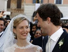 Besotted: The couple, who currently live together in New York, can't take their eyes off each other as they leave the ceremony. Their wedding ceremony took place in one of the oldest churches in Rome