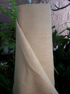 So far, this is the best price I have found on rolls of burlap for the burlap curtains that I want.... one roll is $90, and I THINK that should make approximately 6 curtains... that will span approximately 30'...  Reva