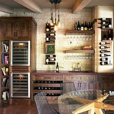 This wine tasting room seems right at home in the kitchen. A combination of bottle storage & glassware racks, dual refrigerators, countertop & wet bar sink along with table seating define the space....wonder if my honey would consider this #winetasting