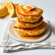 Easy, ultra fluffy lemon ricotta pancakes served with honey or strawberry syrup. A must try!