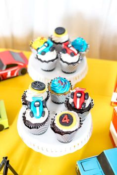 Take a look at the awesome cupcakes at this Race Car Birthday Party! See  more party ideas and share yours at CatchMyParty.com #catchmyparty  #partyideas #racecarparty #racecar #boybirthdayparty #racecarcupcakes