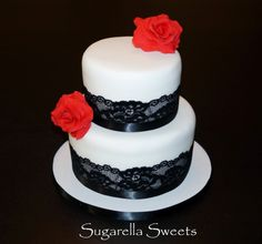 Black and white lace wedding cake with red fondant flowers. www.SugarellaSweets.com