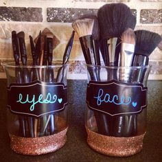 eyes & face makeup brush holder. Painters tape, modge podge, glitter, chalkboard stickers, and chalk pens! Jars are from dollar tree!