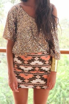sparkly sweater, printed skirt, and big bracelet