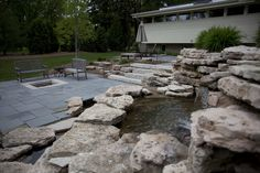 Another view of the bluestone patios, fire pit and water feature.