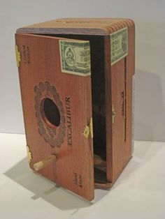 Recycle a cigar box into a bird house with easy access to yearly cleaning.