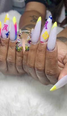 XL Vuitton V French white stiletto Nails with Pink, Purple, Blue yellow nail designs with Bling Bling Rhinestones FreeStyle Nails By Elaine at NAB Nail Bar Las Vegas Book Today Text or call 702-577-1680