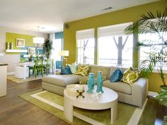 Colorful Living Space: This open and colorful space comfortably houses a living room, kitchen and dining room. From HGTVRemodels.com