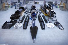 The car (parts pictured) is the result of eight years of research and its visit to London from the project's workshop in Bristol is the latest step in its bid to break the world land speed record in South Africa in 2017