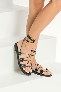 Our signature Danae gladiator sandals are inspired by the ancient Greek wave motif as it also appears in our logo. This black pair is made from chemical-free vegetable-tanned leather with adjustable slim ties that can be worn high up or low at your ankles, detailed with gold plated beads and coins. These top quality lace up sandals have anti-slip rubber sole for optimum comfort suitable for everyday wear from day to night. Available in black, tan, gold, silver and white. Find ypur perfect pair! Boho Sandals, Ankle Wrap Sandals, Lace Up Sandals, Black Sandals, Cow Leather, Black Leather, Leather Gladiator Sandals, Summer Flats, Ancient Greek Sandals