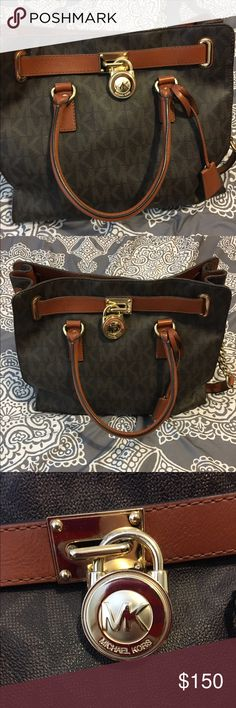 Michael Kors purse Large brown leather Michael Kors purse with gold accents. Small stains inside on bottom lining. Otherwise good condition. Authentic. Michael Kors Bags Shoulder Bags