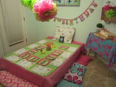 Pancakes & Pajamas Birthday Party - used the boxspring and bedframe from a double bed for the table and pillow seating.
