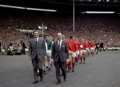 Busby leads his rebuilt side out for the 1963 FA Cup Final. Man United beat Leicester 3-1.  This began the rebirth of Manchester United.  It now had all the pieces in place after the 1958 disaster. Players like Charleton, Best, Law, Sadler, Crerand to name a few.