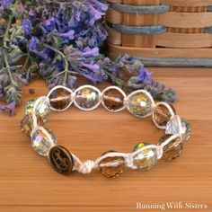 A shamabala bracelet is a macrame friendship bracelet with beads. We'll show you how to tie knots around crystals to make a glamorous shamballa bracelet!