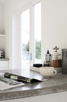 white kitchen + concrete counter