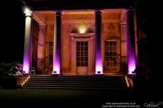 Flood lighting in pink on the pillars and gold under the portico on the West Wycombe estate for a marquee wedding Event Lighting, Outdoor Lighting, Mood Light, Marquee Wedding, After Dark, Professional Photographer, Outdoor Spaces, Mansions, House Styles
